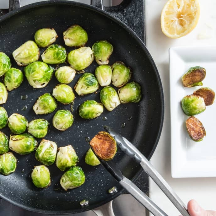 Skillet-Roasted Brussels Sprouts with Lemon and Pecorino Romano | America's Test Kitchen